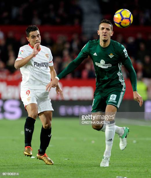 Real Betis' Moroccan defender Zou Feddal challenges Sevilla's French forward Wissam Ben Yedder during the Spanish league football match between...