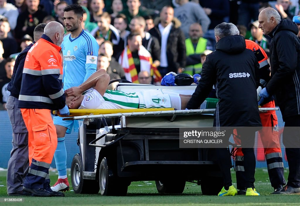Real Betis' Moroccan defender Zou is carried out on a stretcher after an injury during the Spanish league football match between Real Betis and Villarreal CF at the Benito Villamarin stadium in Sevilla on February 03, 2018. /