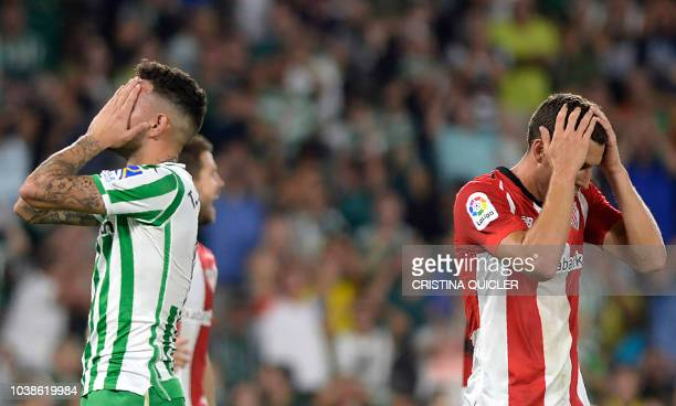 Real Betis' Paraguayan forward Arnaldo Tonny Sanabria and Athletic Bilbao's Spanish midfielder Oscar De Marcos gesture during the Spanish league...