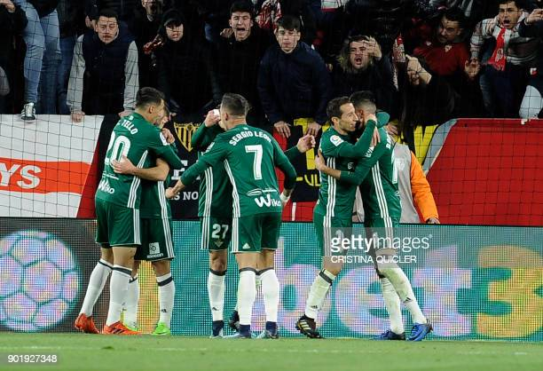 Real Betis' players celebrate a goal during the Spanish league football match between Sevilla and Real Betis at the Sanchez Pizjuan stadium in...