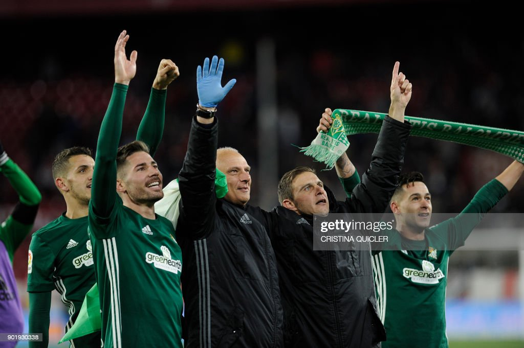 Real Betis' players celebrate at the end of the Spanish league football match between Sevilla and Real Betis at the Sanchez Pizjuan stadium in Sevilla on January 6, 2018. /