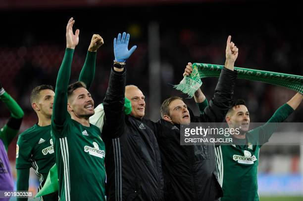 Real Betis' players celebrate at the end of the Spanish league football match between Sevilla and Real Betis at the Sanchez Pizjuan stadium in...