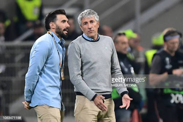 Real Betis' Spanish coach Quique Setien and assitant coach Eder Sarabia talk during the UEFA Europa League group F stage football match AC Milan vs...