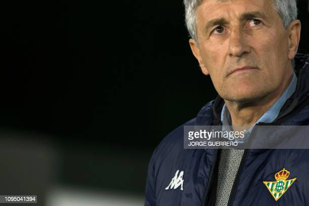 Real Betis' Spanish coach Quique Setien looks on before the Spanish Copa del Rey semifinal first leg football match between Real Betis and Valencia...