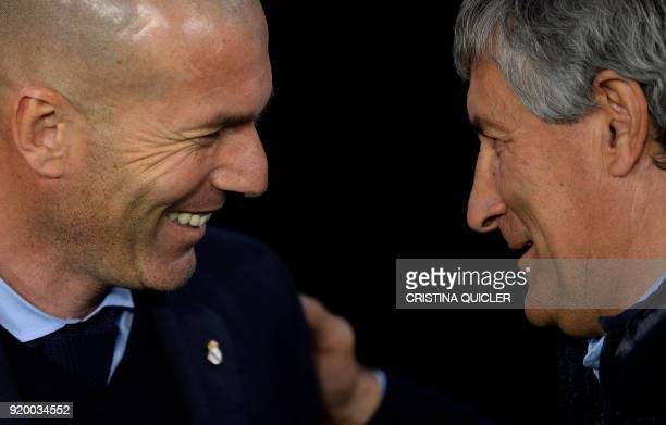 Real Betis' Spanish coach Quique Setien speaks with Real Madrid's French coach Zinedine Zidane before the Spanish league football match Real Betis vs...