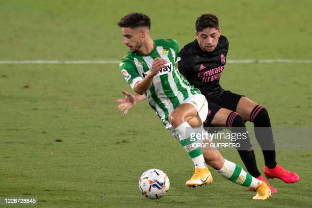 Real Betis' Spanish defender Alexandre Moreno vies with Real Madrid's Uruguayan midfielder Valverde during the Spanish league football match Real...