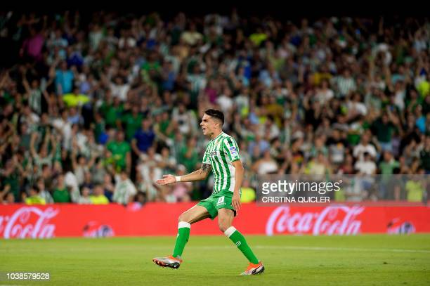 Real Betis' Spanish defender Marc Bartra celebrates after scoring a goal during the Spanish league football match between Real Betis and Athletic...