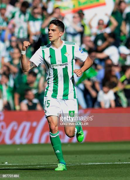 Real Betis' Spanish defender Marc Bartra celebrates after scoring a goal during the Spanish league football match between Real Betis and Sevilla at...