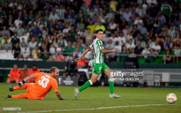 Real Betis' Spanish forward Cristian Tello scores against F91 Dudelange's Luxembourgers goalkeeper Joe Frising during the UEFA Europa League football...