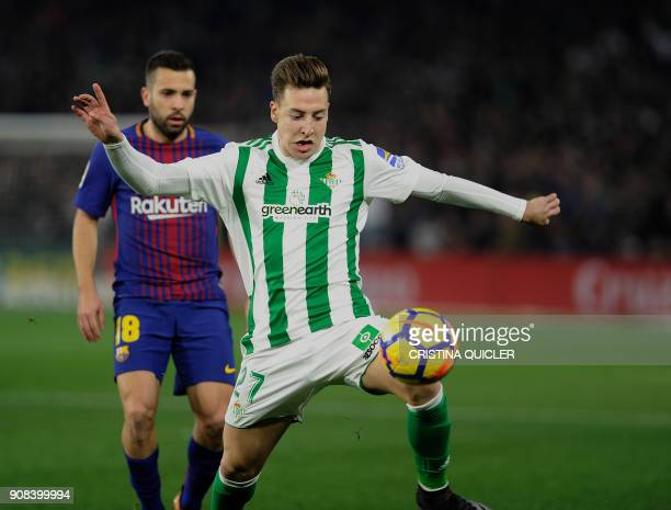 Real Betis' Spanish forward Francis Guerrero challenges Barcelona's Spanish defender Jordi Alba during the Spanish league football match between Real...