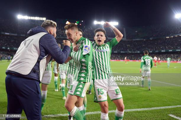 Real Betis' Spanish forward Loren Moron celebrates after scoring a goal during the Spanish league football match Real Betis against Sevilla FC at the...