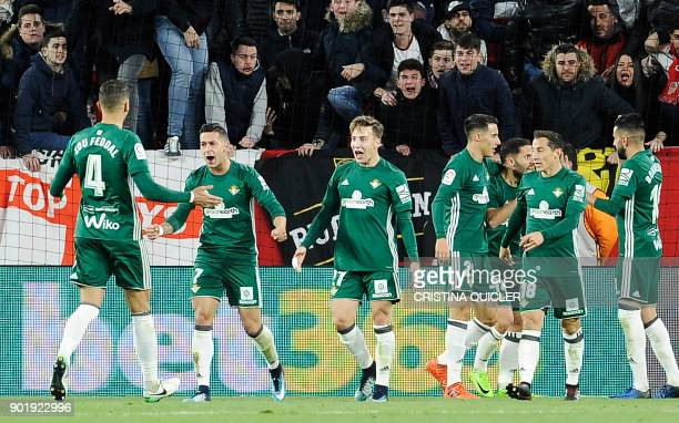 Real Betis' Spanish forward Sergio Leon celebrates with teammates after scoring a goal during the Spanish league football match between Sevilla and...