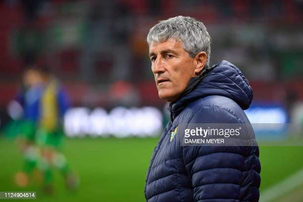 Real Betis' Spanish head coach Quique Setien attends the UEFA Europa League round of 32 firstleg football match between Rennes and Real Betis at the...