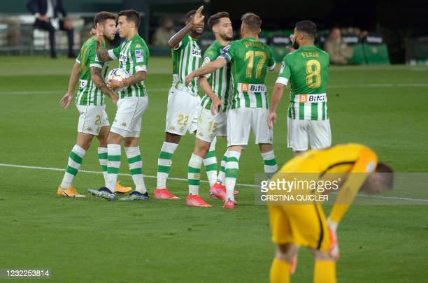 Real Betis' Spanish midfielder Cristian Tello celebrates his goal with teammates during the Spanish League football match between Real Betis and Club...
