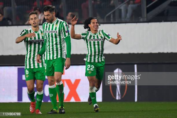 Real Betis' Spanish midfielder Diego lainez celebrates after scoring a goal during the UEFA Europa League round of 32 firstleg football match between...
