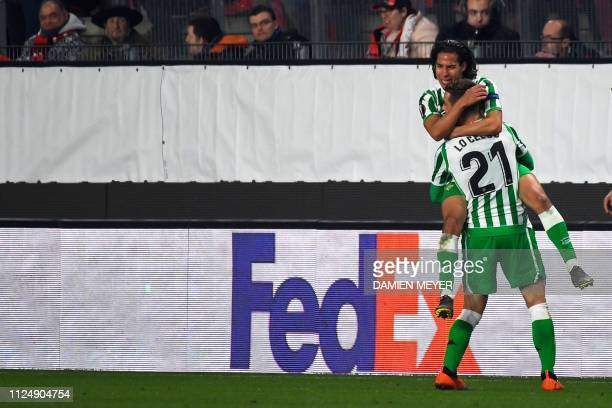 Real Betis' Spanish midfielder Diego lainez celebrates with Real Betis' Spanish midfielder Giovanni Lo Celso after scoring a goal during the UEFA...