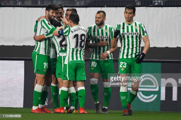 Real Betis' Spanish midfielder Diego lainez celebrates with teammates after scoring a goal during the UEFA Europa League round of 32 firstleg...