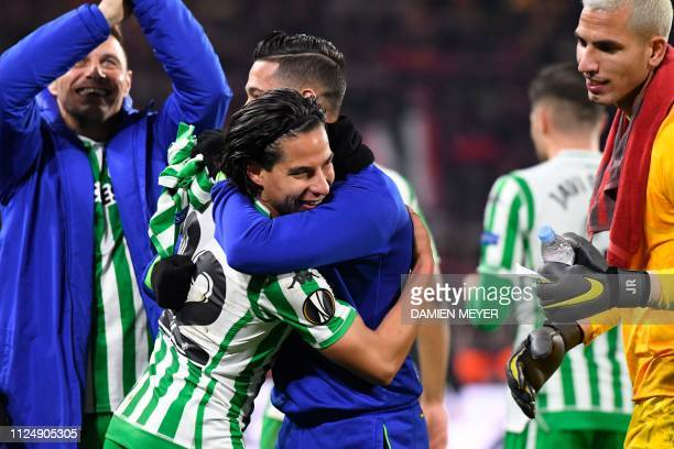 Real Betis' Spanish midfielder Diego lainez is congratulated a draw in the UEFA Europa League round of 32 firstleg football match between Rennes and...