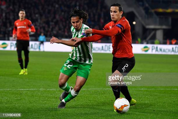 Real Betis' Spanish midfielder Diego lainez vies for the ball with Rennes' Algerian defender Mehdi Zeffane during the UEFA Europa League round of 32...