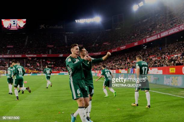Real Betis' Spanish midfielder Fabian Ruiz celebrates with teammates after scoring a goal during the Spanish league football match between Sevilla...