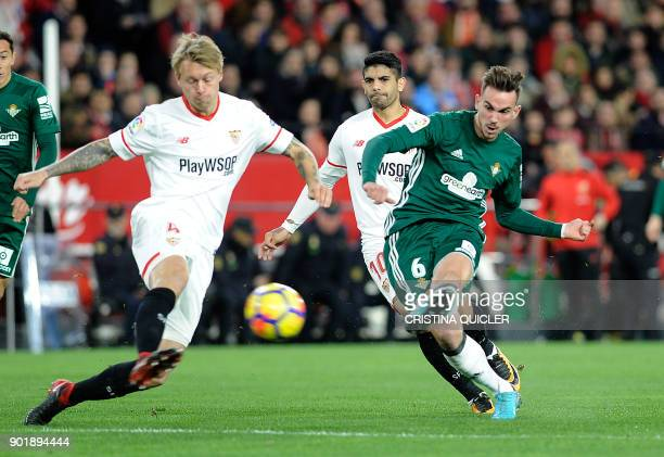 Real Betis' Spanish midfielder Fabian Ruiz scores a goal during the Spanish league football match between Sevilla and Real Betis at the Sanchez...