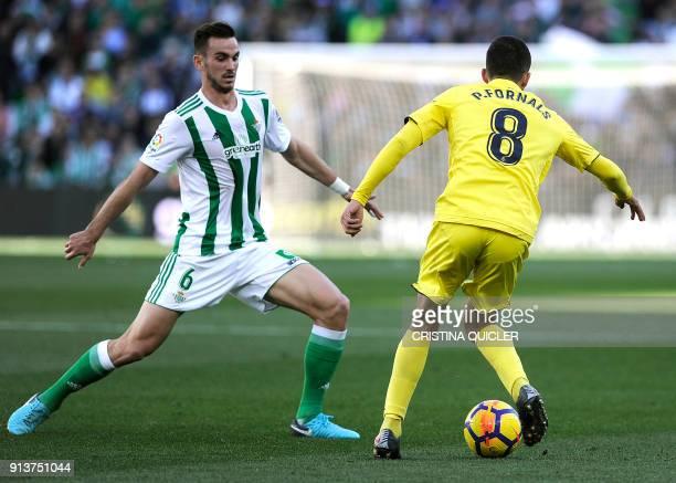 Real Betis' Spanish midfielder Fabian Ruiz vies with Villarreal's Spanish midfielder Pablo Fornals during the Spanish league football match between...