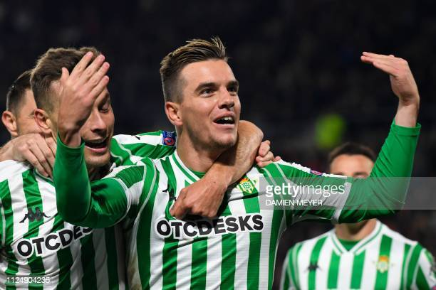Real Betis' Spanish midfielder Giovanni Lo Celso celebrates after scoring a goal during the UEFA Europa League round of 32 firstleg football match...