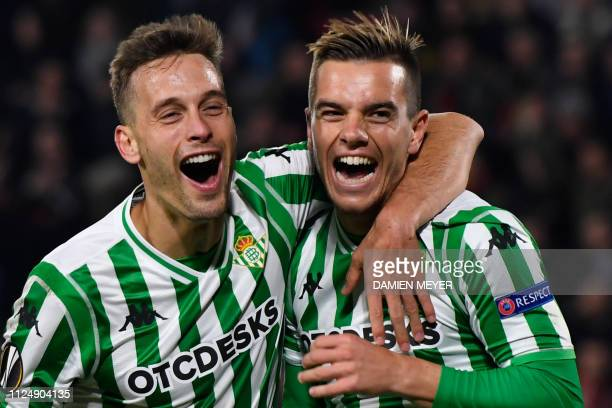 Real Betis' Spanish midfielder Giovanni Lo Celso celebrates with Real Betis' Spanish defender Sergio Canales after scoring a goal during the UEFA...