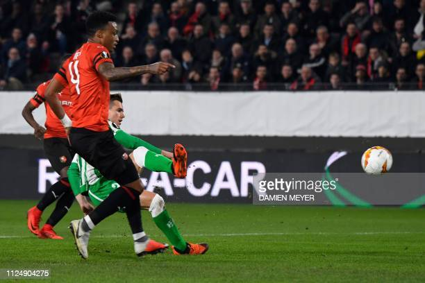 Real Betis' Spanish midfielder Giovanni Lo Celso scores a goal past Rennes' Mozambican defender Mexer during the UEFA Europa League round of 32...