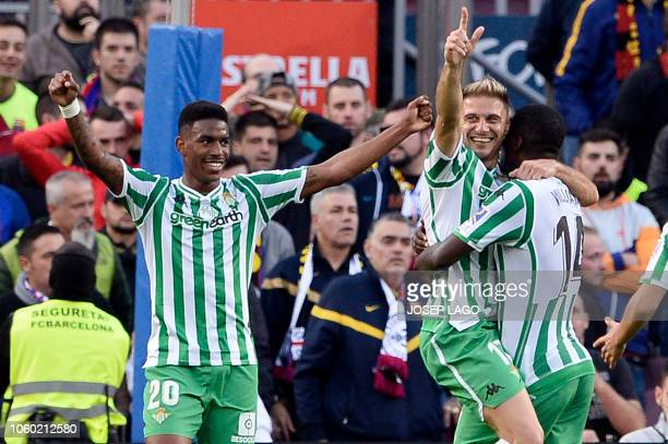Real Betis' Spanish midfielder Joaquin celebrates scoring his team's second goal with Real Betis' Portuguese midfielder William Carvalho and Real...