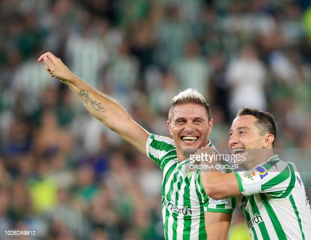 Real Betis' Spanish midfielder Joaquin celebrates with Real Betis' Mexican midfielder Andres Guardado at the end of the Spanish league football match...