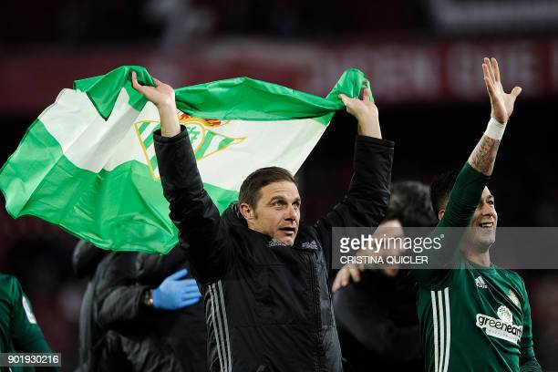 Real Betis' Spanish midfielder Joaquin celebrates with teammates at the end of the Spanish league football match between Sevilla and Real Betis at...