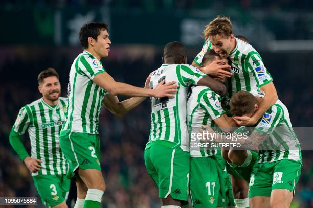 Real Betis' Spanish midfielder Joaquin celebrates with teammates scoring their second goal during the Spanish Copa del Rey semifinal first leg...