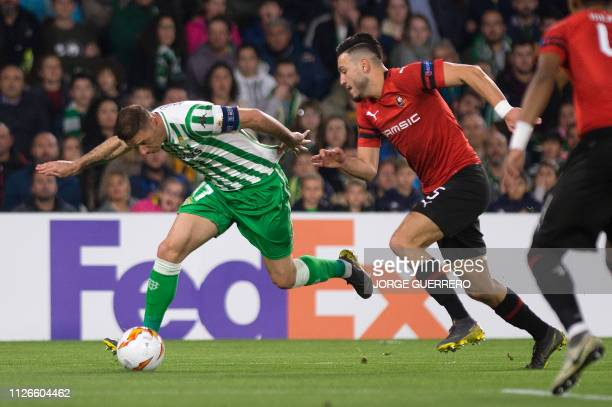 Real Betis' Spanish midfielder Joaquin Sanchez vies for the ball with Rennes' Algerian defender Ramy Bensebaini during the UEFA Europa League round...