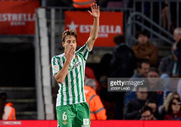 Real Betis' Spanish midfielder Sergio Canales celebrates his team's fourth goal during the Spanish league football match between FC Barcelona and...