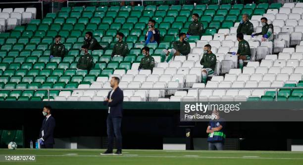 Real Betis substitutes sit behind the bench during the Liga match between Real Betis Balompie and Granada CF at Estadio Benito Villamarin on June 15,...