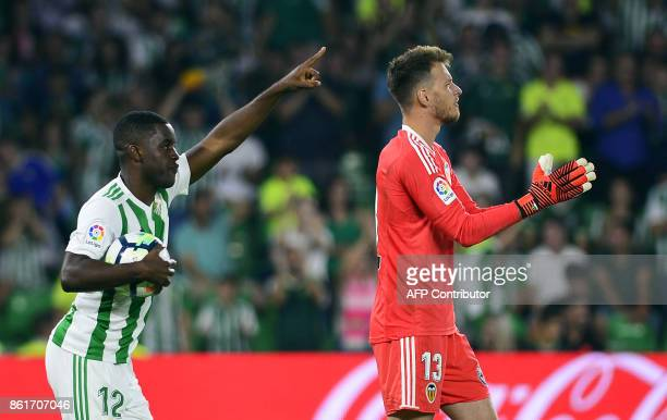 Real Betis's Costa Rican midfielder Joel Nathaniel Campbell celebrates after scoring a goal beside Valencia's Brazilian goalkeeper Neto during the...