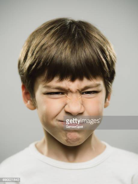 real boy showing disgusted expression - kid middle finger stock pictures, royalty-free photos & images