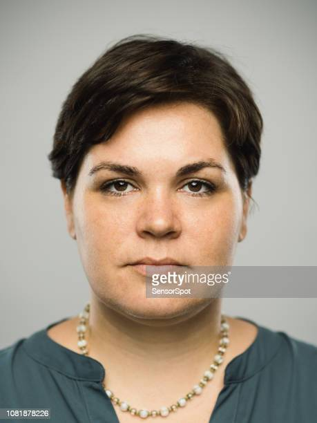 real caucasian adult woman with blank expression - chubby asian woman stock pictures, royalty-free photos & images