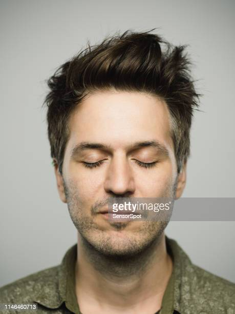 real caucasian man with blank expression and eyes closed - eyes closed stock pictures, royalty-free photos & images