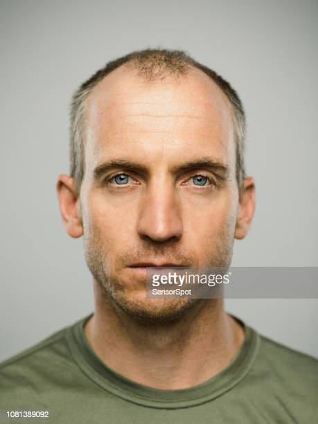 real caucasian man with blank expression - blank expression stock pictures, royalty-free photos & images