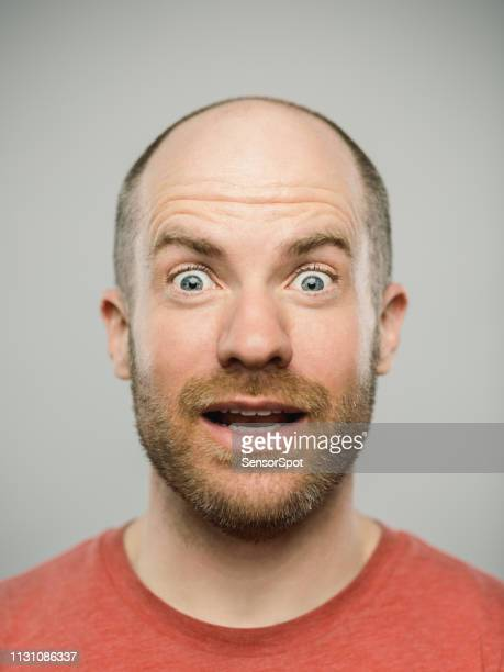 real caucasian man with surprised expression looking at camera - surprise stock pictures, royalty-free photos & images