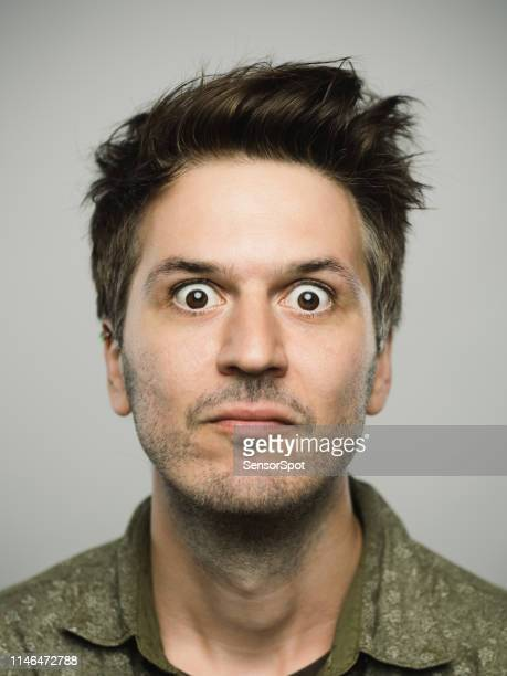 real caucasian man with surprised expression looking at camera - fear stock pictures, royalty-free photos & images