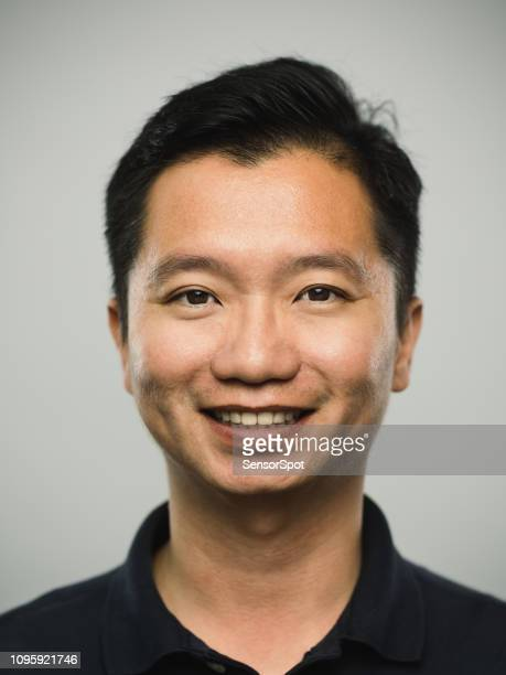 real chinese man with excited expression - east asian ethnicity stock pictures, royalty-free photos & images