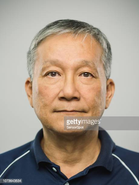 real chinese senior man with blank expression - police mugshot stock pictures, royalty-free photos & images