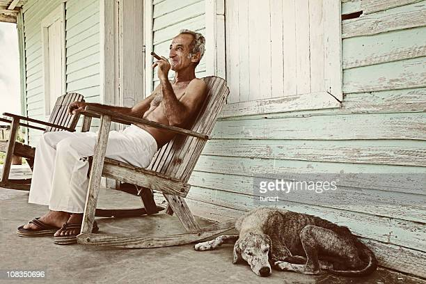 real cuban man and his dog infront of his house - pinar del rio stock photos and pictures
