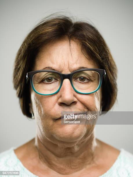 Real displeased senior woman portrait