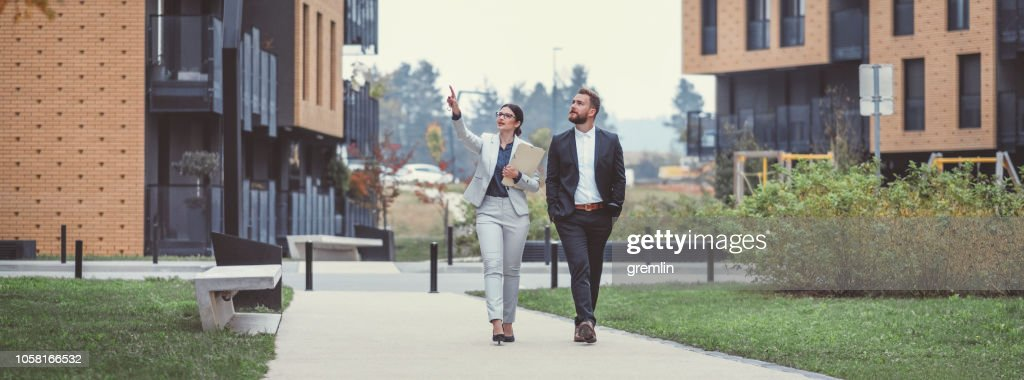 Real estate agent and businessman customer : Stock Photo