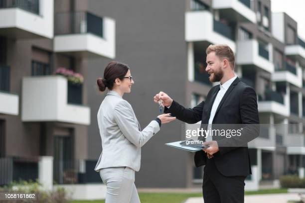 real estate agent and businesswoman customer - computer key stock pictures, royalty-free photos & images