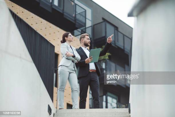 real estate agent and businesswoman customer - real estate developer stock pictures, royalty-free photos & images